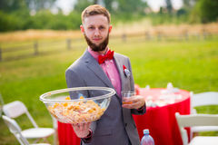 Groom Chips and Drink Royalty Free Stock Photos