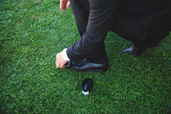 Groom Cleaning Shoes Royalty Free Stock Image