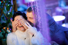 Groom closing eyes to bride Royalty Free Stock Photos