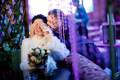 Groom closing eyes to bride Stock Photo
