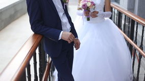 Groom comes to the bride stock footage