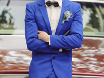 Groom with Crossed Hands. In blue jacket Royalty Free Stock Photos