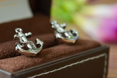 Groom cufflinks shaped anchor stock photography