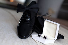 Groom cufflinks, shoes and papillon Stock Image