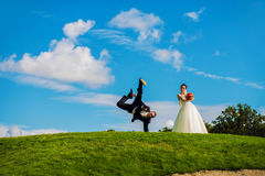 Groom dancing upside down on sky Royalty Free Stock Photos