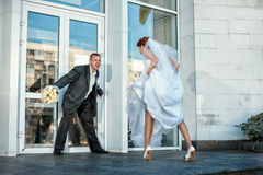 Groom does not let the bride at a wedding. Stock Images