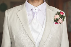Groom dressed in white Stock Image