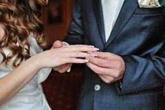 Groom dresses bride wedding ring Stock Photos