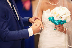 Groom dresses a ring on  finger to the bride Royalty Free Stock Photo