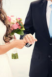 Groom dresses a ring on  finger to the bride Stock Photos