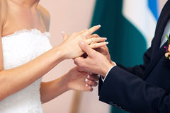 Groom dresses a ring on  finger to the bride Royalty Free Stock Photography
