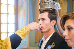 Groom Drinking Wine at Church Ceremony Royalty Free Stock Images