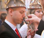 Groom drinking wine Stock Photo