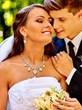 Groom embrace bride Royalty Free Stock Images