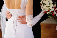 Groom embraces the bride, bride corset Royalty Free Stock Photography