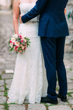 The groom embraces the bride in the old town. Wedding in Montene Royalty Free Stock Photos