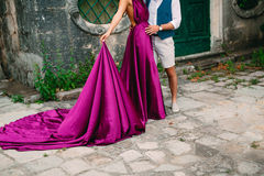 The groom embraces the bride in the old town. Wedding in Montene Stock Photo