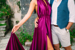 The groom embraces the bride in the old town. Wedding in Montene Royalty Free Stock Photo