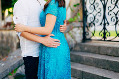 The groom embraces the bride in the old town. Wedding in Montene Royalty Free Stock Images