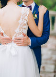 The groom embraces the bride in the old town. Wedding in Montene Royalty Free Stock Image