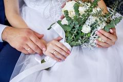 Groom embraces the bride with a wedding bouquet of flowers for a walk Stock Photos