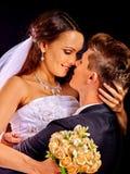 Groom embracing bride Stock Photos