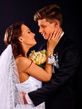 Groom embracing bride Royalty Free Stock Photography