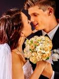 Groom embracing bride Royalty Free Stock Photo