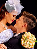Groom embracing bride Royalty Free Stock Image