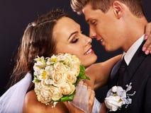 Groom embracing bride Royalty Free Stock Photos