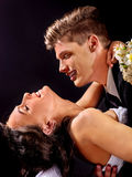 Groom embracing bride Stock Photography