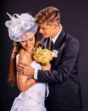 Groom embracing bride Stock Image