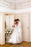 The groom embracing bride near the mirror Royalty Free Stock Photo