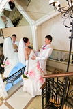 The groom embracing bride near the mirror Stock Images