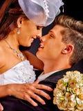 Groom embracing bride Stock Photo