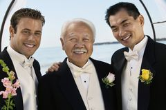 Groom with father and best man outdoors (portrait) Stock Images