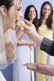Groom feeding his bride some wedding cake. Stock Photo