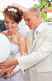 A groom and fiancee cut off air marbles Royalty Free Stock Image