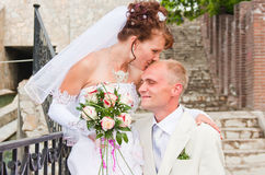 Groom and fiancee in a park. Happy groom and fiancee in a park Stock Photography