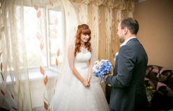 Groom first time meets his bride at her house Royalty Free Stock Photography