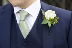 Groom with flower Royalty Free Stock Photography