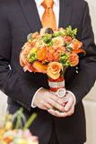 Groom and flowers Stock Images