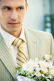 Groom with flowers Royalty Free Stock Photo