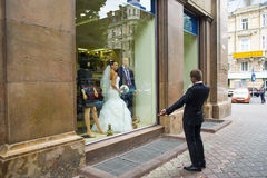 The groom found the bride in the showcase. Royalty Free Stock Photography