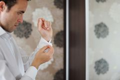 Groom getting ready Stock Images