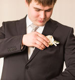 Groom is getting ready for his wedding day Royalty Free Stock Photo