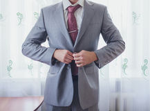 Groom getting ready in suit Stock Photo