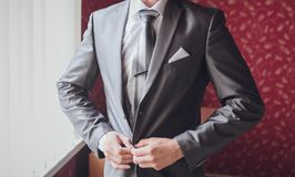 Groom getting ready in suit Royalty Free Stock Images