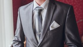 Groom getting ready in suit Stock Image