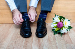 Groom getting ready for wedding Stock Image